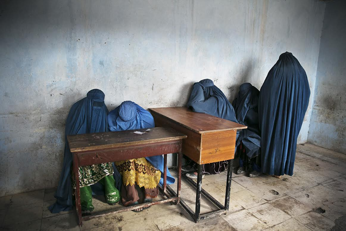 Burqa-clad women wait to vote after a polling station runs out of ballots. (Kabul, April 5, 2014)