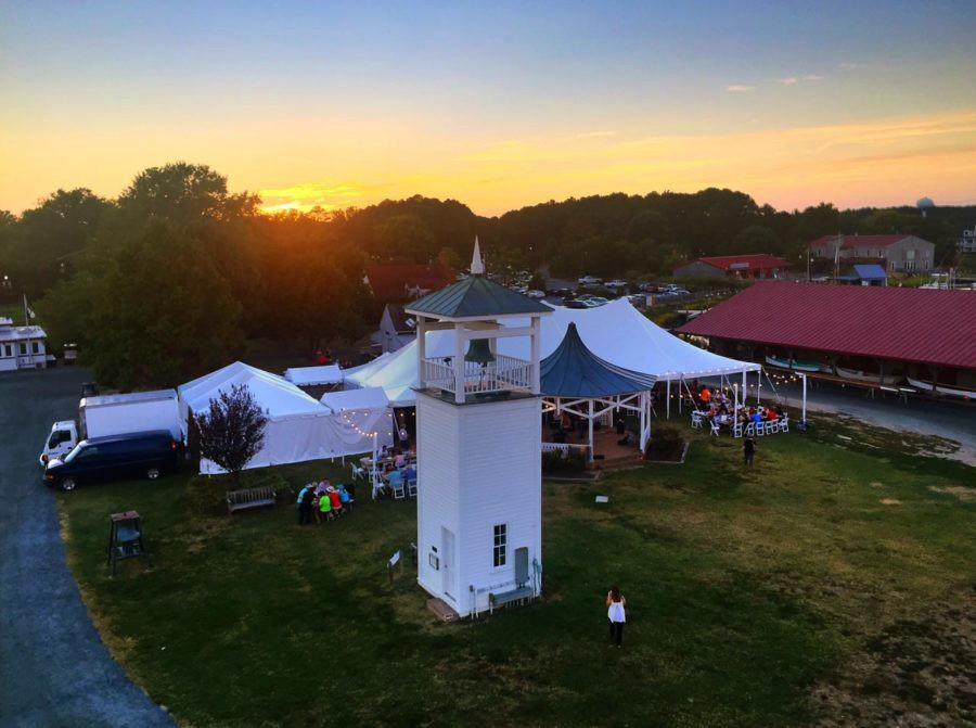 Sun sets on the Crab feast on the grounds of the Chesapeake Bay Maritime Museum