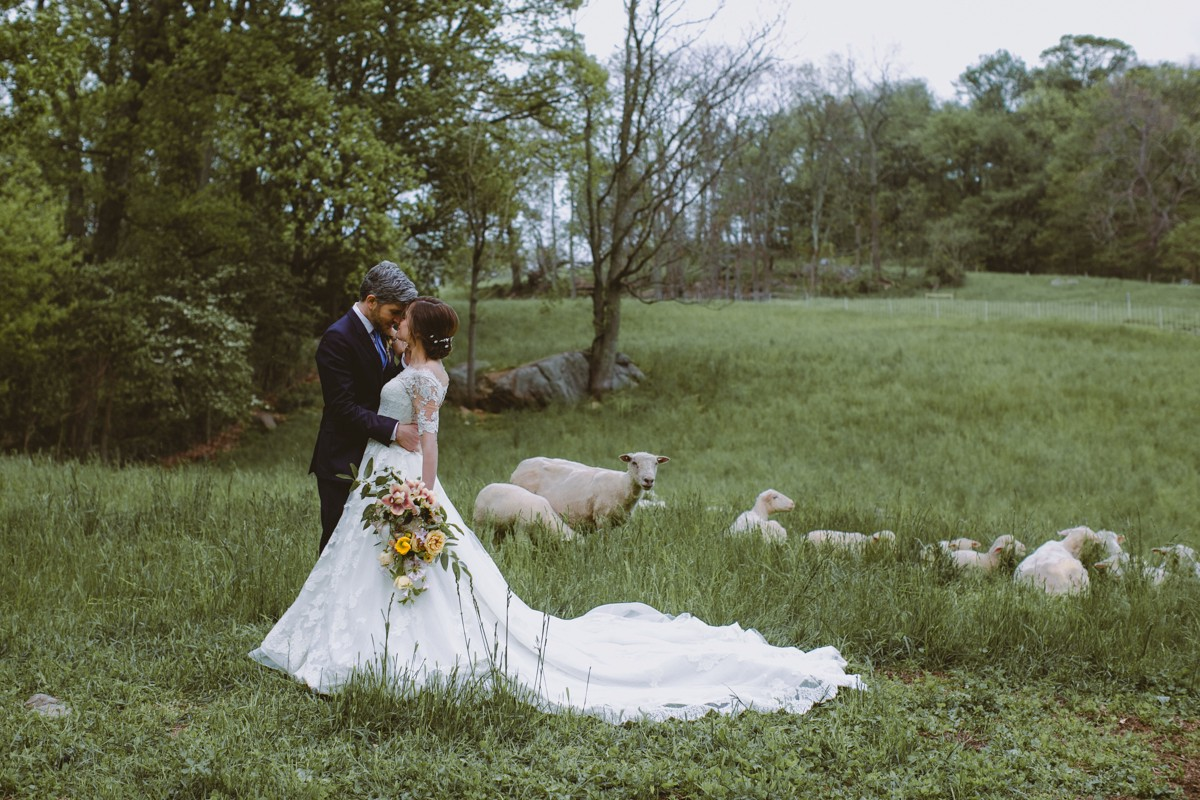 wedding portrait with sheep - http://ruffledblog.com/modern-country-meets-secret-garden-wedding