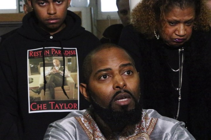 Che Taylor's brother Andre Taylor, at center, speaks at a news conference to respond to Seattle Police Department's Sunday fatal shooting of Che Taylor, Tues., Feb. 23, 2016, in Seattle. Che's nephew Kylynn Taylor is at left; Che's mother Joyce Dorsey is at right. (Credit: Seattle Times)