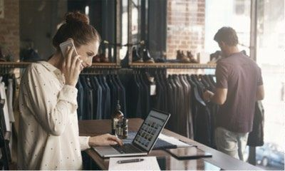 eCommerce clothing shop owner browsing her online store