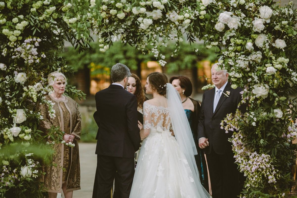 wedding ceremony with greenery - http://ruffledblog.com/modern-country-meets-secret-garden-wedding
