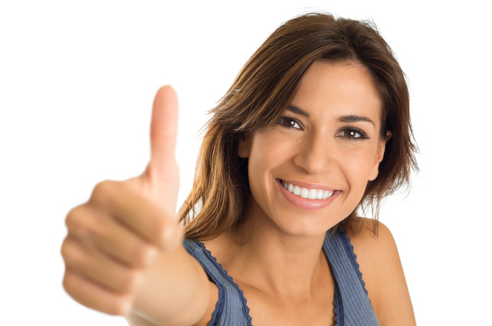 Woman giving a thumbs up.