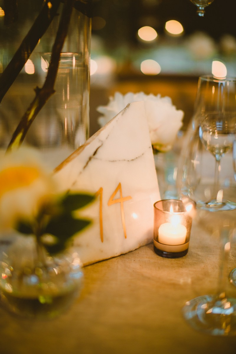 quartz table number - http://ruffledblog.com/modern-country-meets-secret-garden-wedding