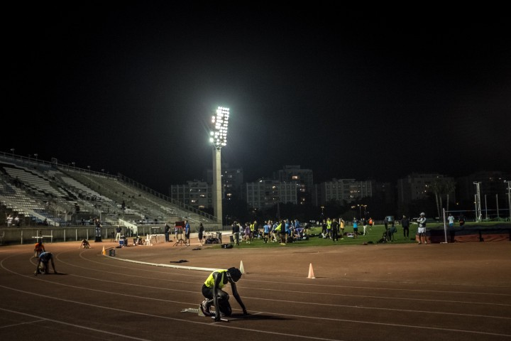 South Sudanese asylum seeker and athlete Esteer (center) prepares to compete at the National Sport Center Stadium in Tel Aviv, Israel.