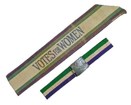 A belt and pewter buckle from the suffrage era. The buckle depicts a woman haunting the Houses of Parliament, a popular 1907 design called 'The Haunted House.' Photo credit: the-saleroom.com