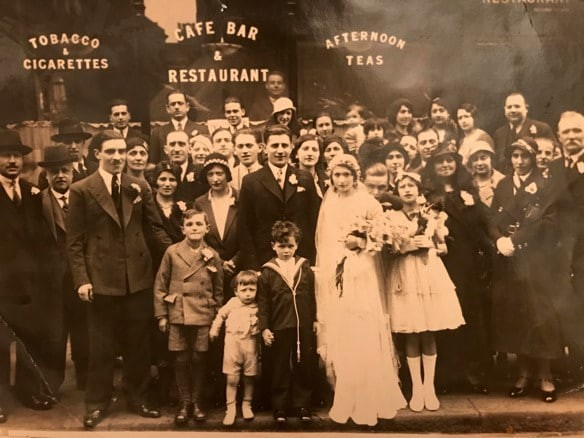 1933 photograph of wedding party outside Bianchi's cafe bar and restaurant in Frith Street, Soho, London