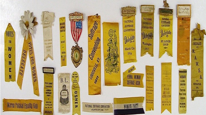 Women's suffrage ribbons date back to as early as 1867 when they gained their traditional yellow color as a reference to an Kansas political campaign and the state's official flower. Photo credit: http://womansuffragememorabilia.com.