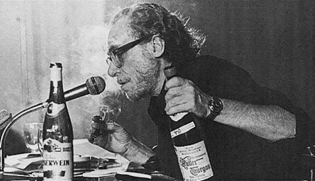 Bukowski wtih beer and cigarette at a microphone