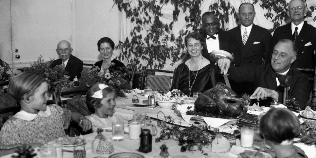 President Franklin D. Roosevelt Carving the Thanksgiving Turkey, November 30, 1933. When FDR Tried To Mess With Thanksgiving, It Backfired Big Time. Photo Courtesy HuffPost.