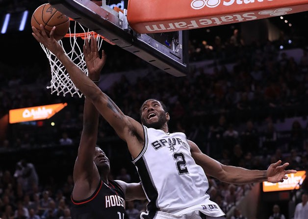 Kawhi Leonard #2 of the San Antonio Spurs drives against Clint Capela #15 of the Houston Rockets during Game Two of the NBA Western Conference Semi-Finals at AT&T Center on May 3, 2017 in San Antonio, Texas.