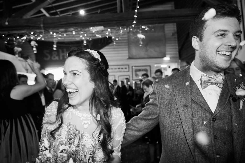 wedding regrets - black and white image of smiling bride and groom