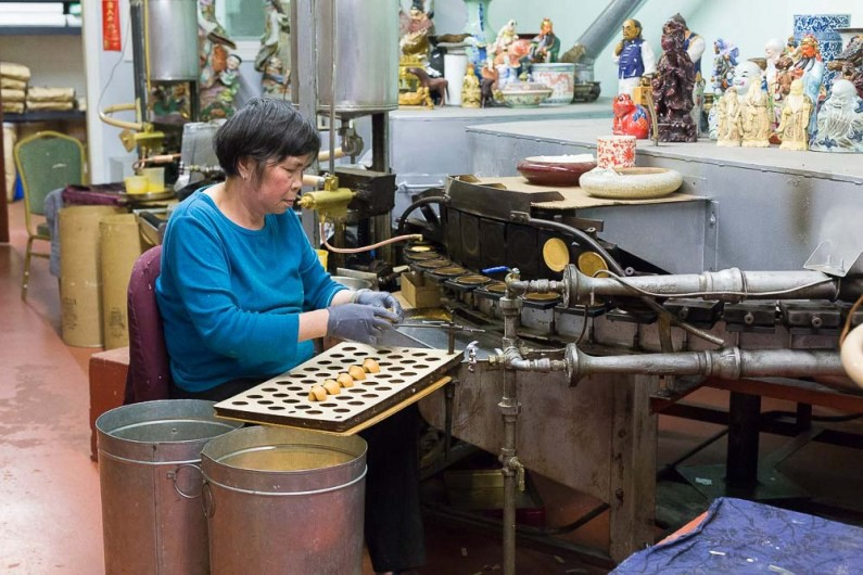 The lady behind the fortune cookies at Golden fortune cookie factory // Exploring San Francisco's Chinatown, California -- gonewithawhim.com