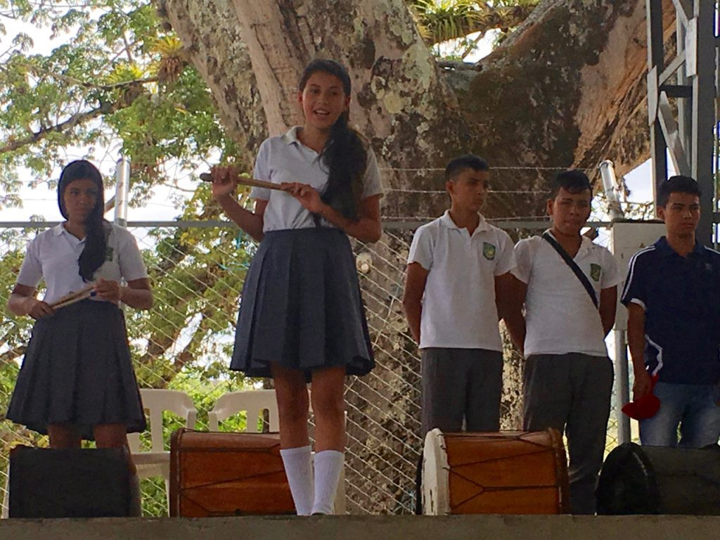 Leader of the school Chirimía ensemble presents her group