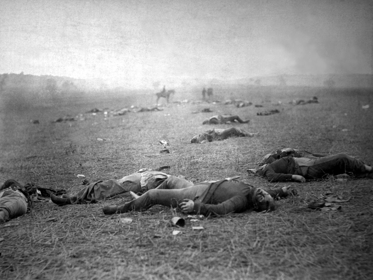 A harvest of death, Gettysburg, PA. Dead Federal soldiers on battlefield.   Author: Timothy H. O'Sullivan