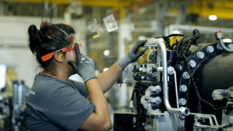 Worker using google glass on a factory floor