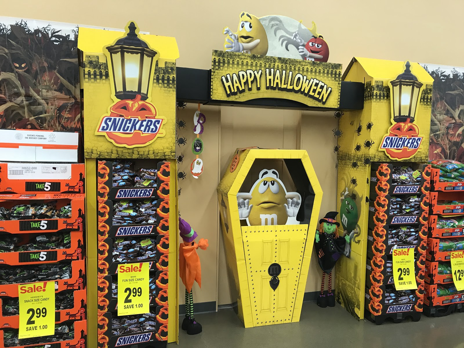theres a lot happening here ghouls goblins that bright yellow mm in an even brighter coffin and americas favorite halloween staple candy