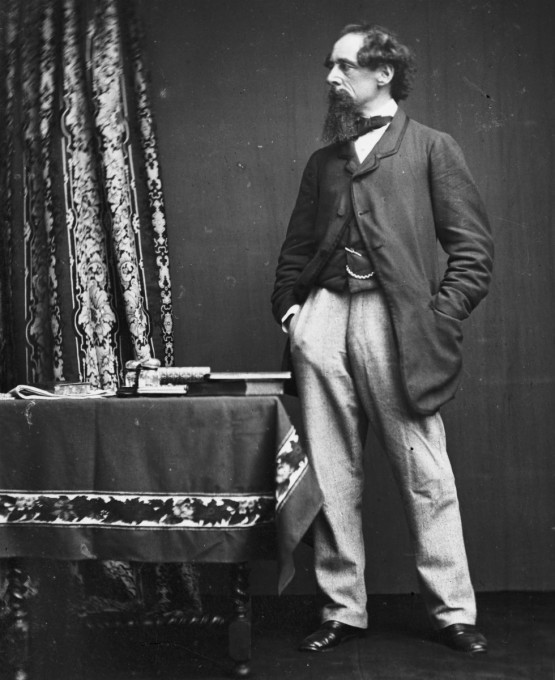 Charles Dickens standing