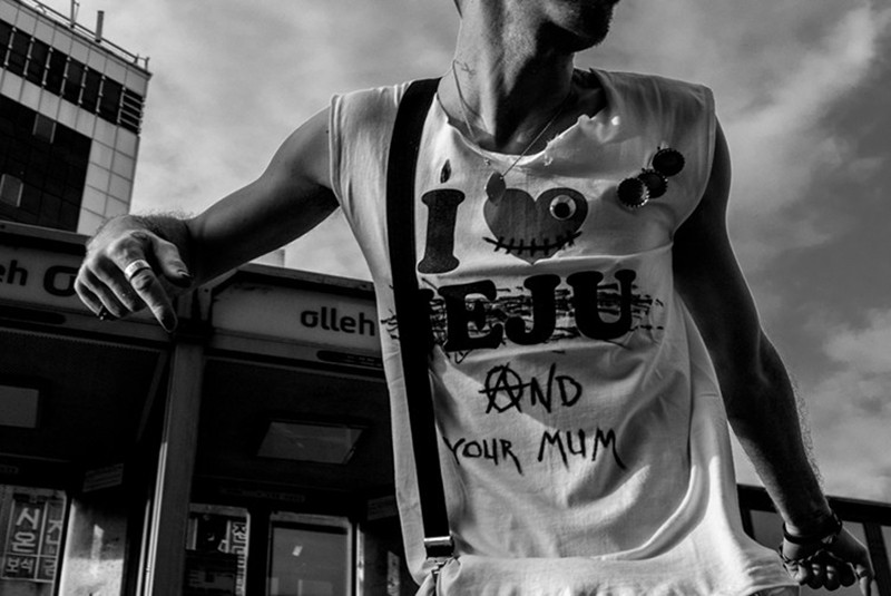 Olivier Duong 4 close up of man's t-shirt with slogans