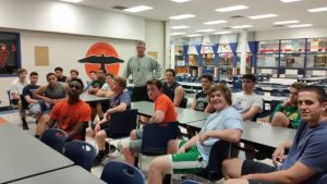 Pennsbury head football coach Dan McShane meets with his linemen for some classroom coaching. Photo by Al Thompson