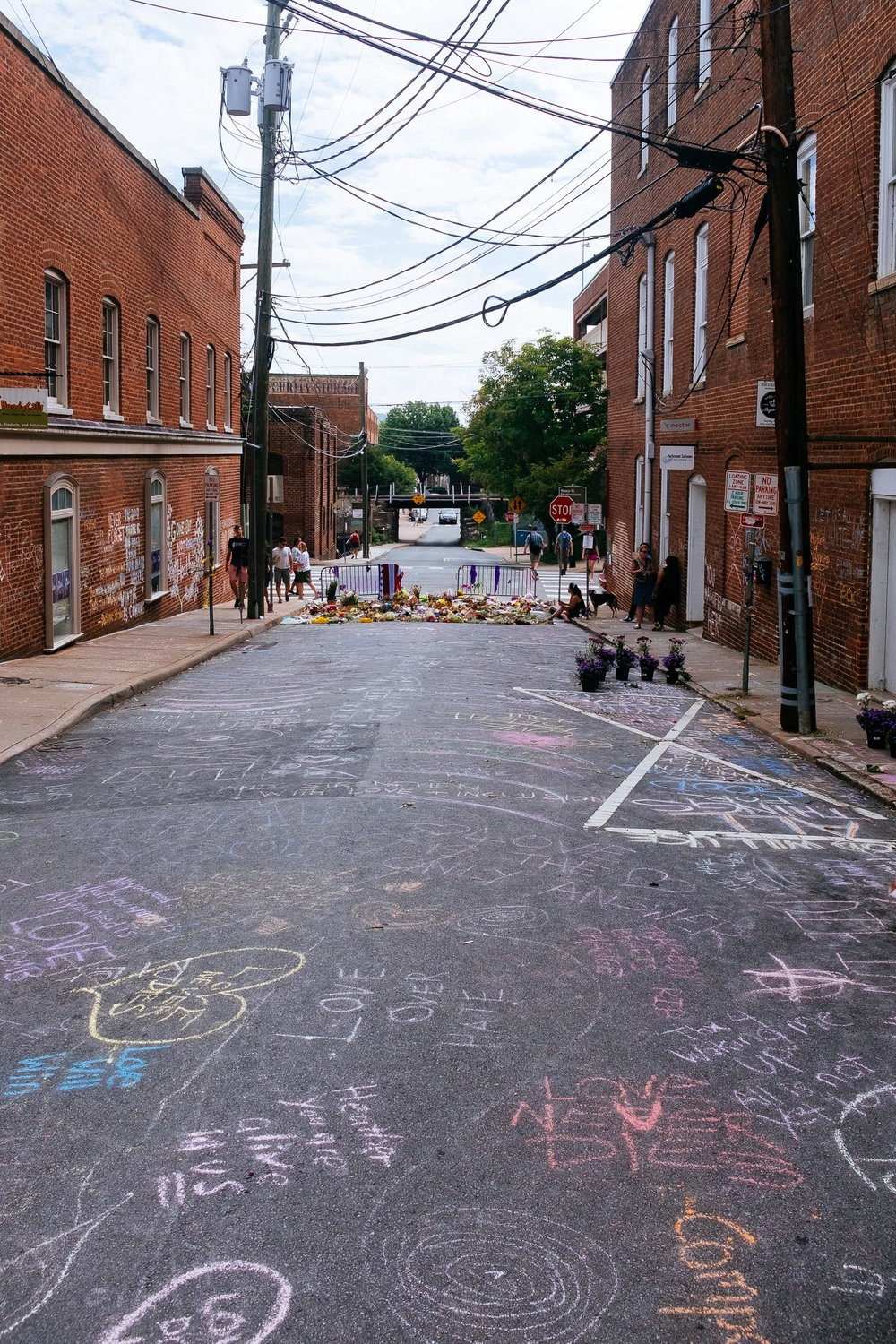 The sad scene of Heather Herrer's Death in Charlottesville, VA. We returned the next day and the rain had washed this away, but the next day another box of chalk was placed at the site.