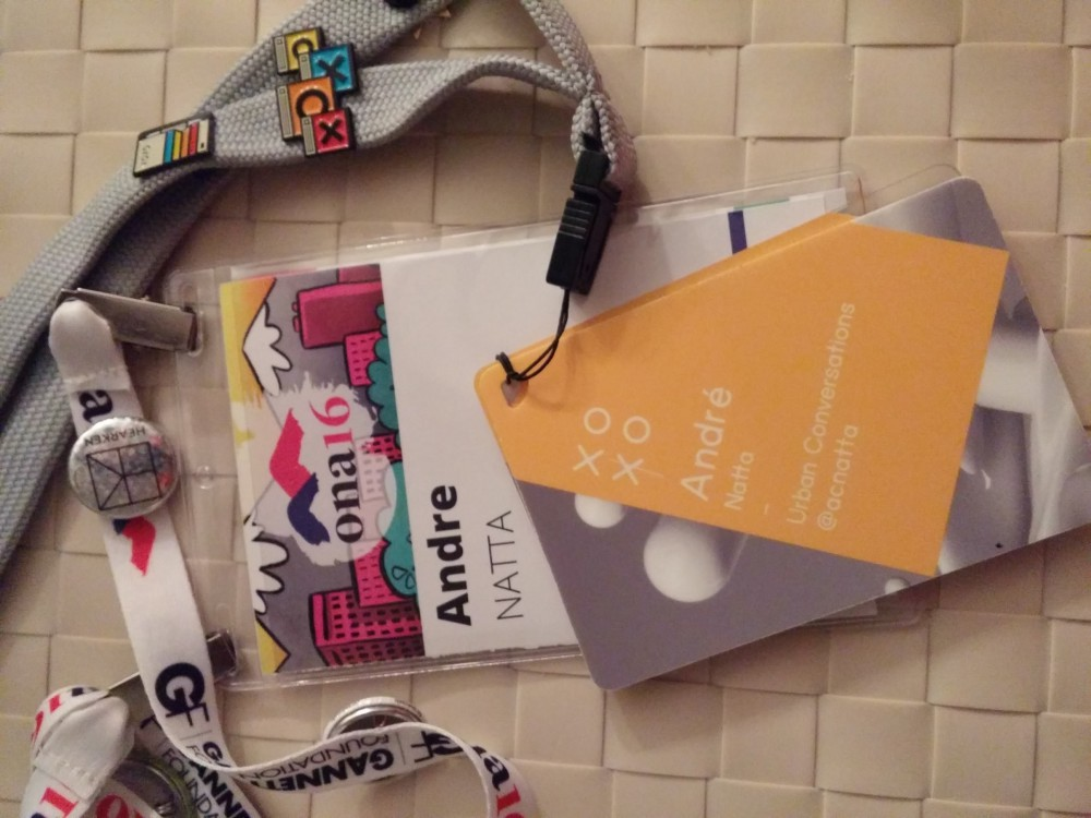 My attendee badges for ONA16 and XOXO.