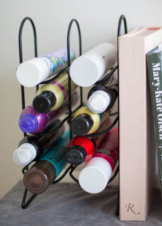 organizing your hairsprays with a wine rack