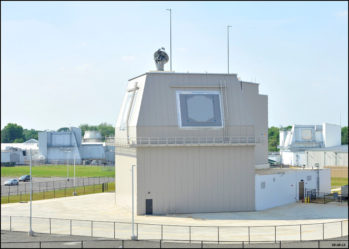 """Above - the Aegis Ashore """"deckhouse."""" Missile Defense Agency photo. At top - USS Ross arrives in Spain in 2014. Navy photo"""