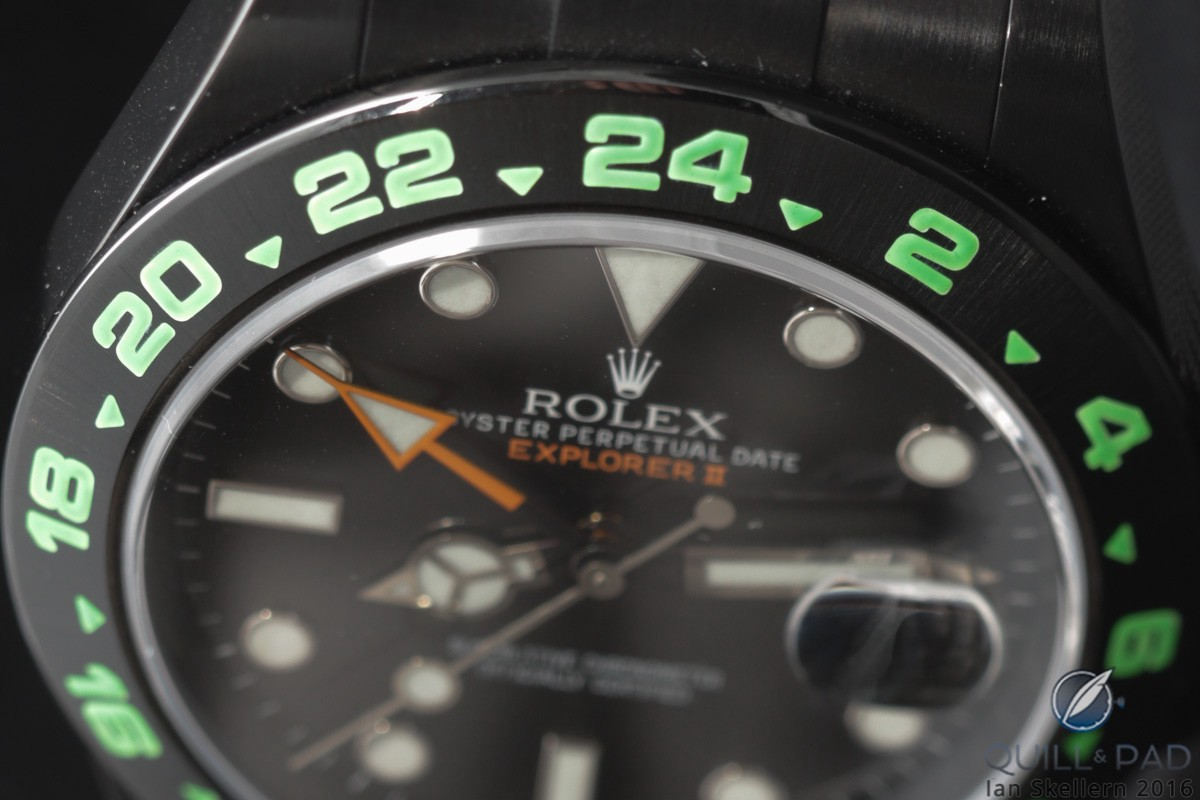 Electric green numerals on the bezel on this blackened Rolex Explorer II