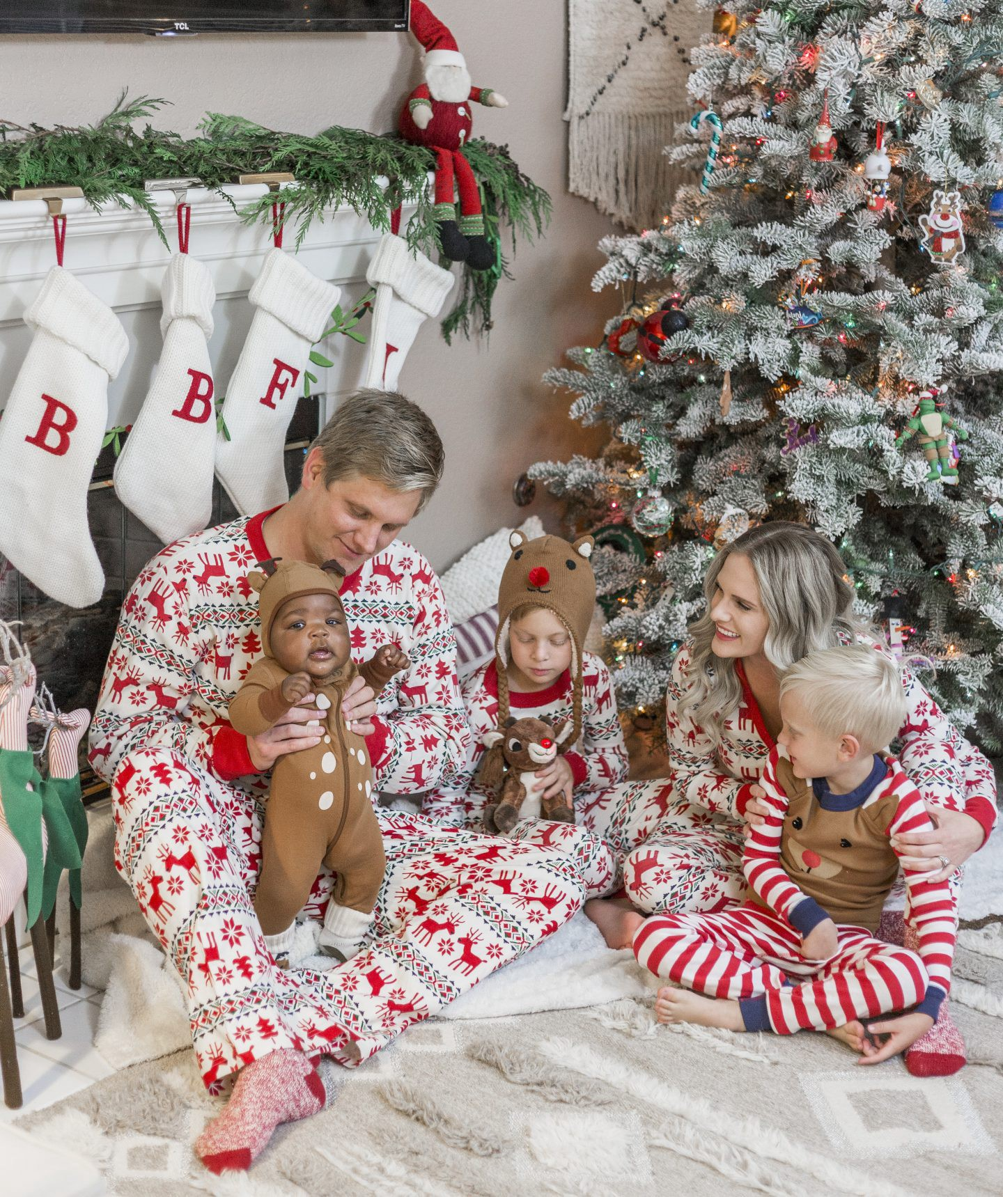 Cute Holiday PJs for your Whole Family featured by top Orange County fashion blog, Dress Me Blonde: image of a family wearing matching Hanna Andersson Holiday PJs