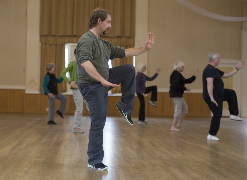 Tai Chi instructor Art Baner, center, leads a Tai Chi class on Wednesday, April 29, 2015 at the Majestic banquet hall in Bellingham, Washington. Baner has been practicing the Chinese martial art for more than 25 years. Jake Parrish / Klipsun Magazine