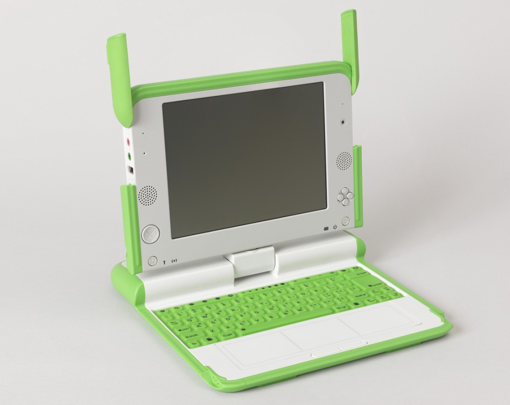 One Laptop Per Child XO Computer, 2007; Designed by Yves Béhar, Bret Recor and fuseproject; injection molded abs plastic and polycarbonate, printed rubber, liquid crystal display, electronic components; steel, copper wire (power plug); H x W x D (closed): 3.5 × 22.9 × 24.1 cm (1 3/8 in. × 9 in. × 9 1/2 in.); Gift of George R. Kravis II; 2015-5-8-a,b; Object Record