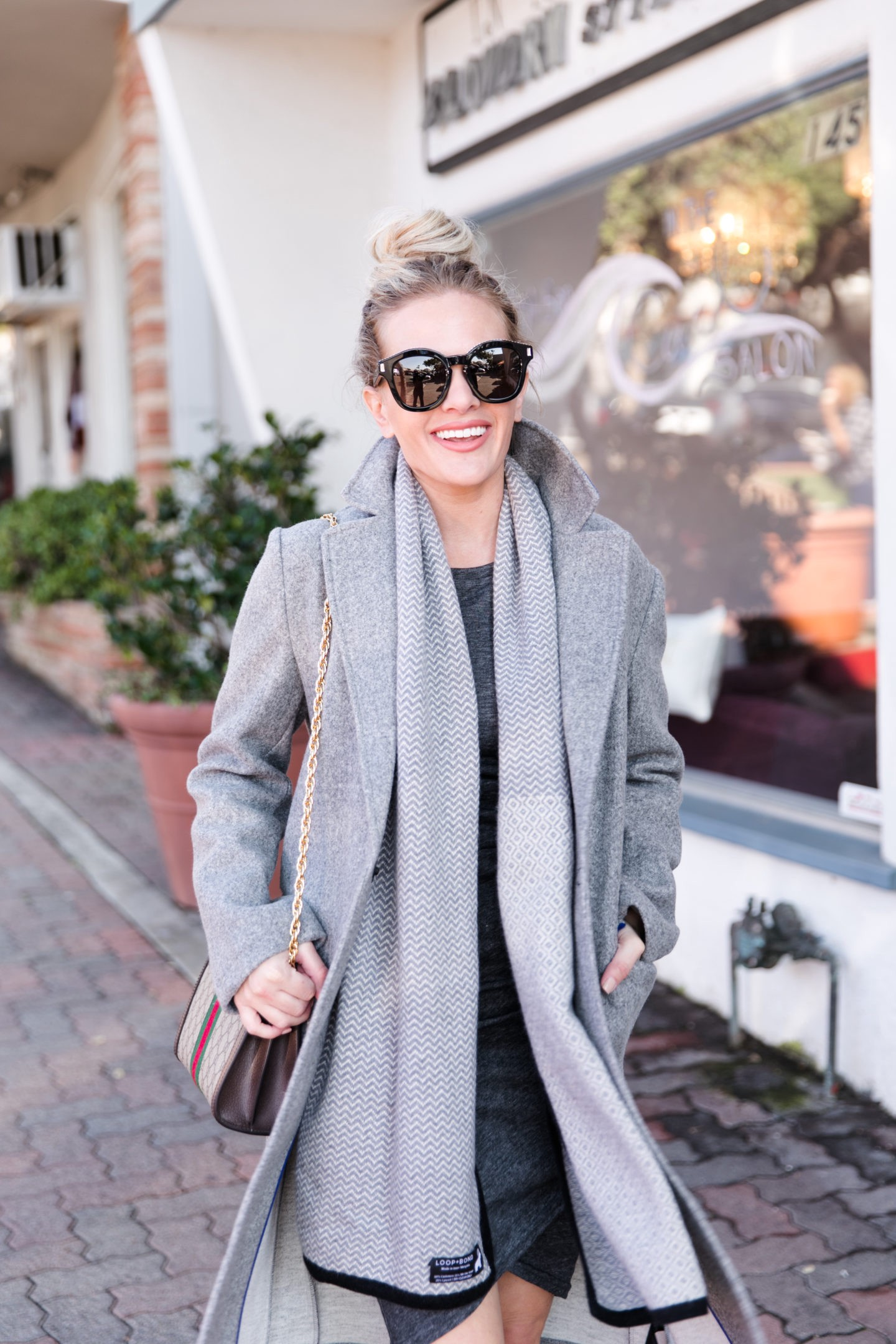 Grey Ruched Dress featured by top US fashion blog, Dress Me Blonde: image of a blonde woman walking down the street wearing a Leith grey rushed dress, a Patch Pocket Coat available at Nordstrom, a cashmere scarf, Sam Edelman pumps and a Gucci shoulder bag
