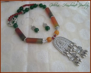 Necklace set – Red Agate, Green and Yellow Jade with tribal pendant and half hoop earrings INR 1700