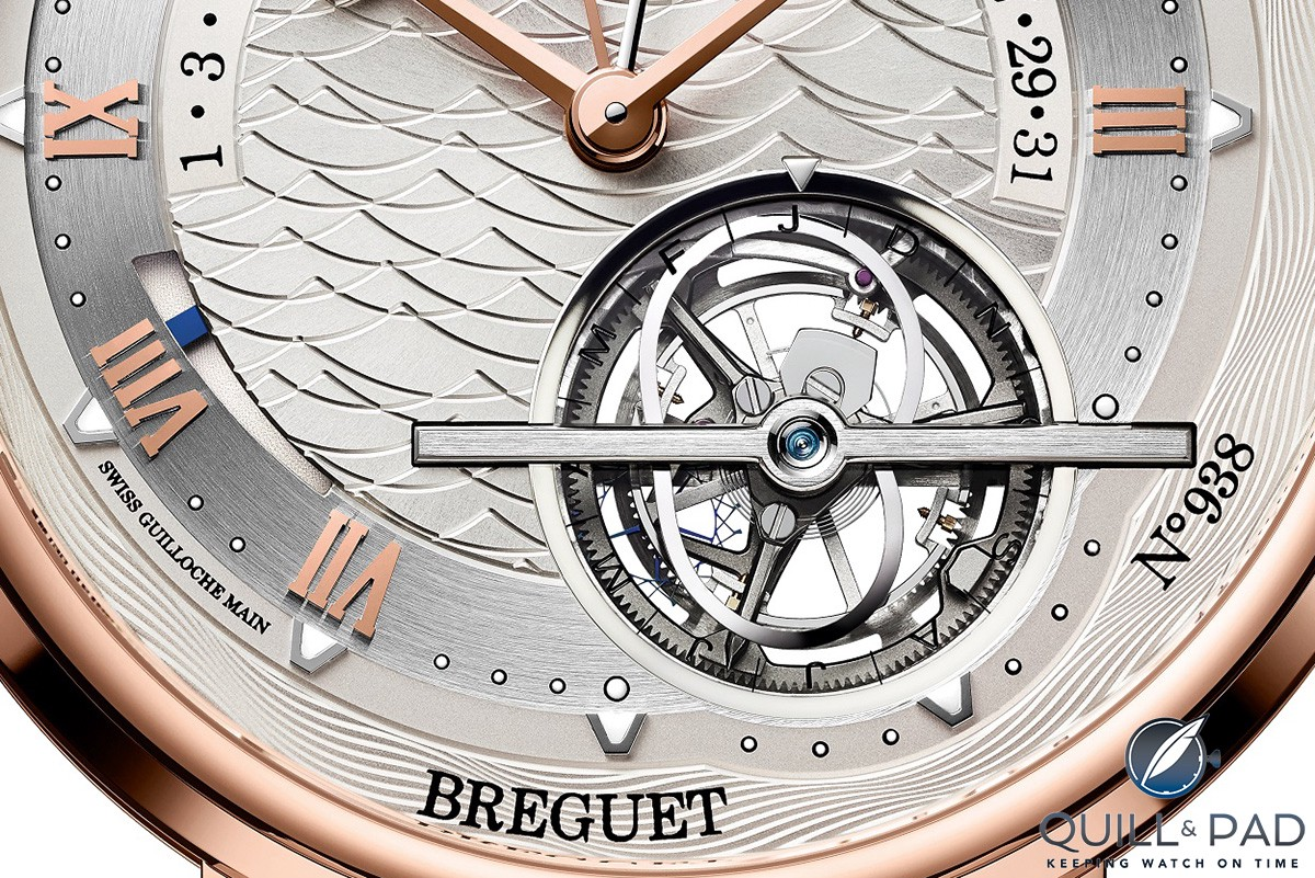 Peanut shaped equation of time track over the tourbillon on the Breguet Marine Équation Marchante with the small ruby tracking pin just visible at 1 o'clock inside the track