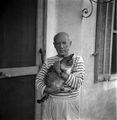Pablo Picasso holding a cat