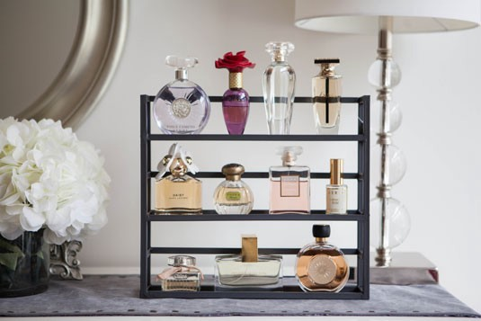 organize your perfume bottles using spice rack