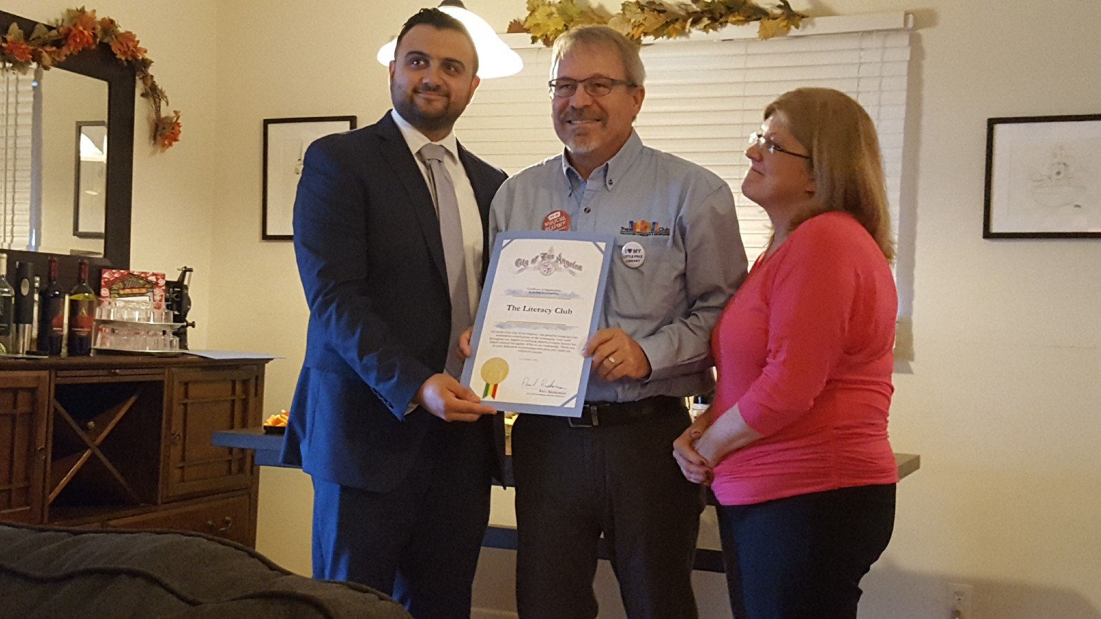 Sahag Yedalian representing Paul Krekorian's office presents a certificate of appreciation from the City of Los Angeles to Jean and Doug Chadwick for their work on The Literacy Club's behalf.