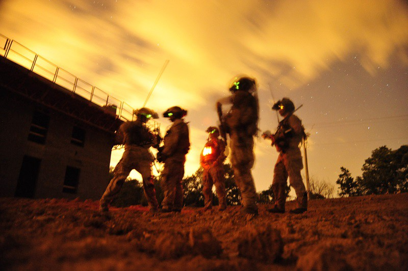 A squad of U.S. Navy SEALs participate in Special Operations Urban Combat training. The training exercise familiarizes special operators with urban environments and tactical maneuvering during night and day operations.