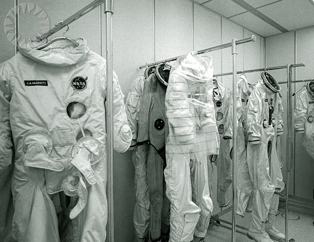 SI Neg. 2000-1384. Date: na. NASA caption, 'The G-4C space suits to be worn by the Gemini IV flight crew, Astronauts James A. McDivitt and Edward H. White II, hang in the suit storage area at NASA's John F. Kennedy Space Center, Cape Kennedy, Florida'; May 28, 1965. Credit: unknown (Smithsonian Institution)