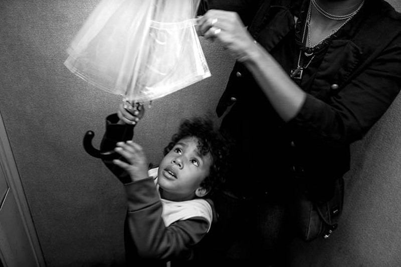Olivier Duong photo of a child with Umbrella