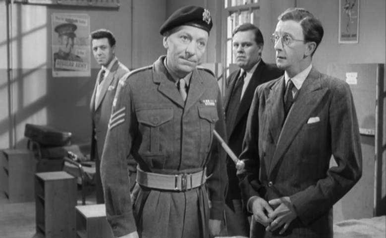 The Sergeant bends a skeptical ear to Golightly's excuses.