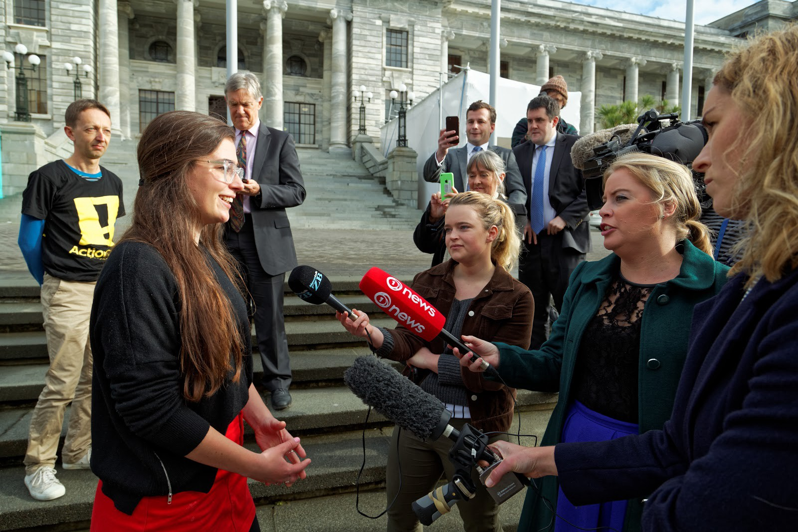 Lucy McSweeney speaks to the media scrum at her petition delivery event for Better Mental Health Education.
