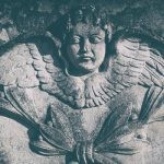 A 19th-century stone carved angel in a cemetery