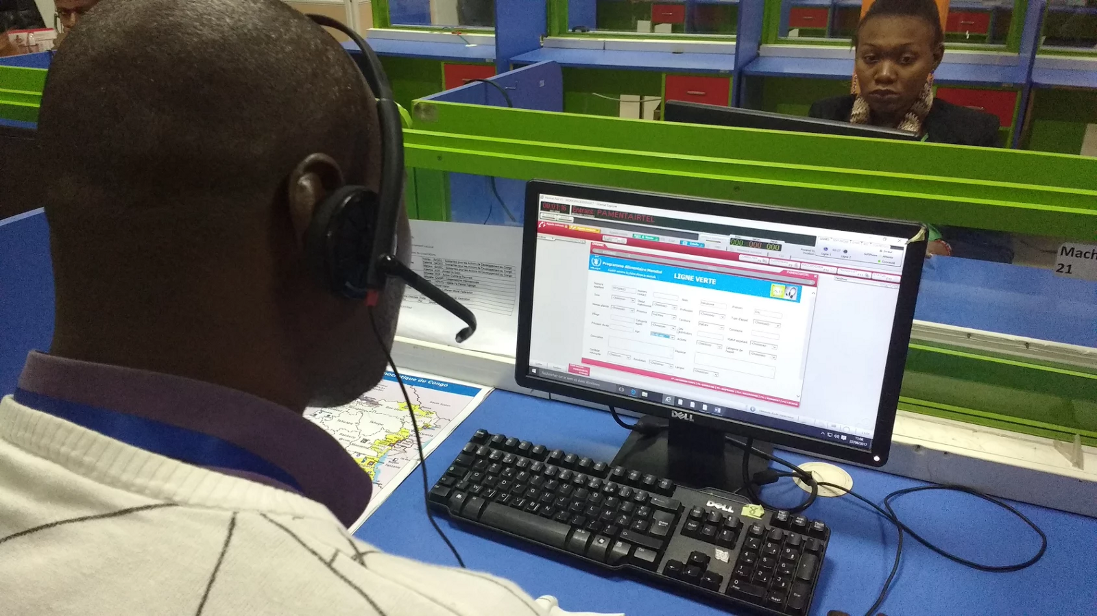 Congo Call Center operator on the phone with a WFP beneficiary to discuss WFP's activities