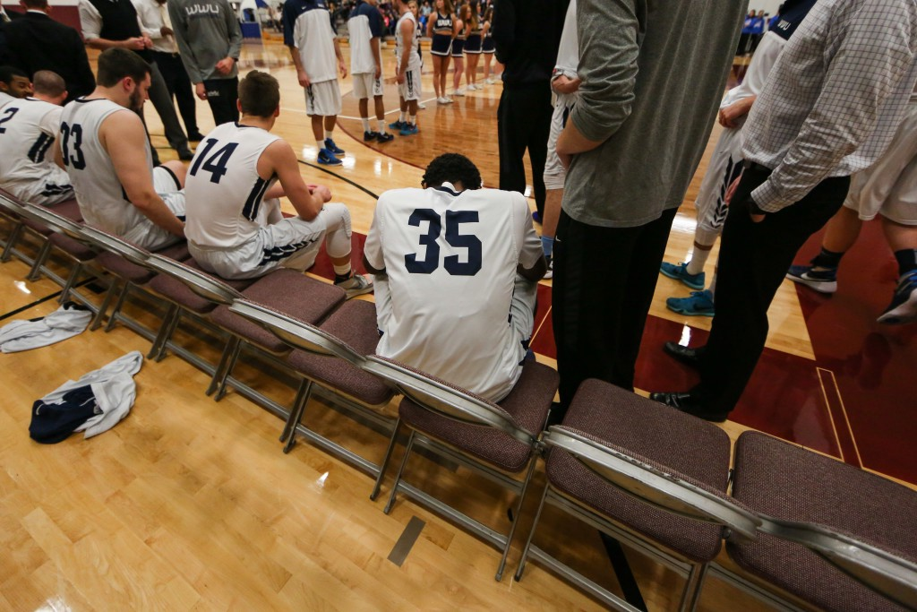 Taking a final moment to himself, Jeff sits quietly on the bench, waiting to hear his name, as the announcer calls out each starter for the Western Washington University Vikings.