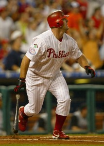 PHILADELPHIA - JUNE 14:  Jim Thome #25 of the Philadelphia Phillies watches his 400th career homerun leave the park on a two out, full count pitch from Jose Acevedo of the Cincinnati Reds which tied the score 2-2 in the first inning before rain delayed the game after 2 1/2 innings with the Reds winning 4-3 during MLB action at the Citizens Bank Park on June 14, 2004 in Philadelphia, Pennsylvania. (Photo by Doug Pensinger/Getty Images)
