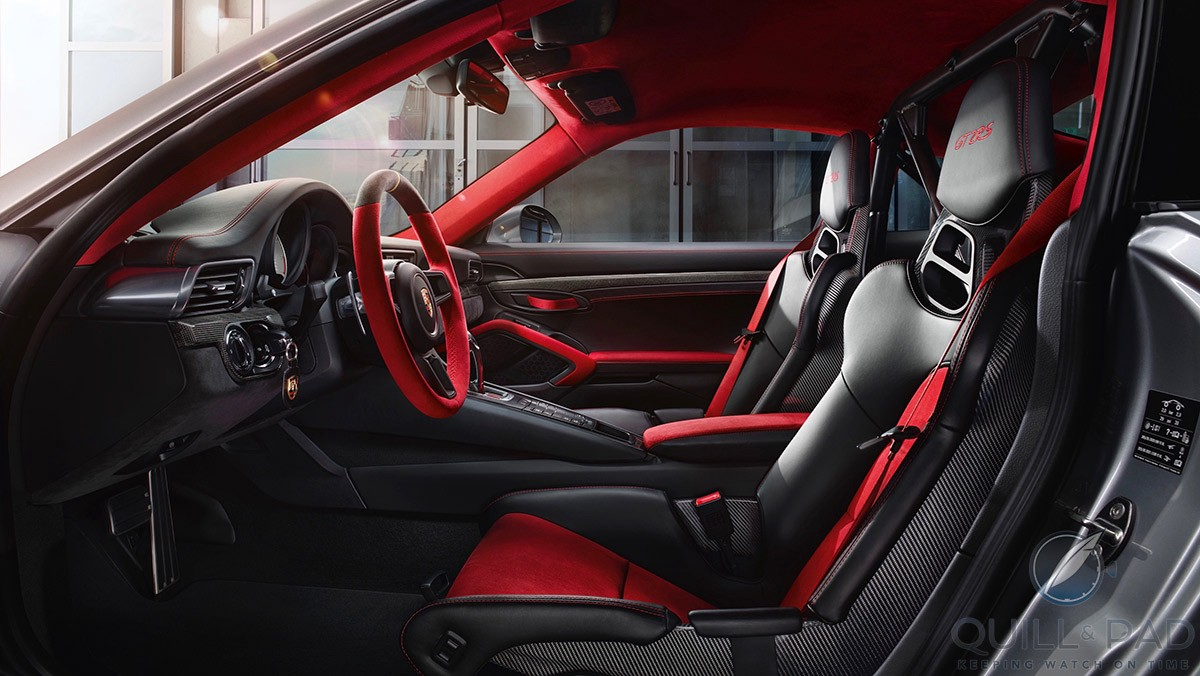 Striking bright red highlights and trim in the interior of the 2018 Porsche 911 GT2 RS