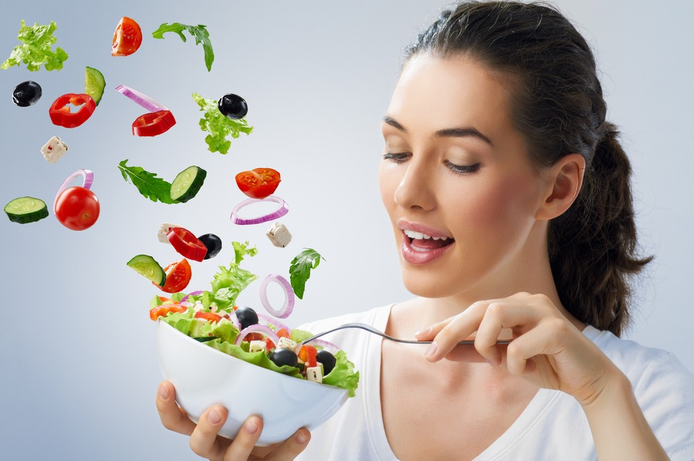 Woman eating floating salad.