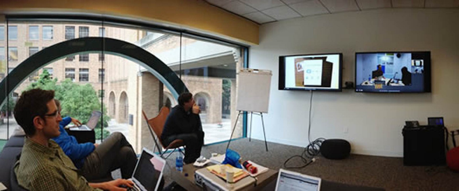 group watching a usability test together